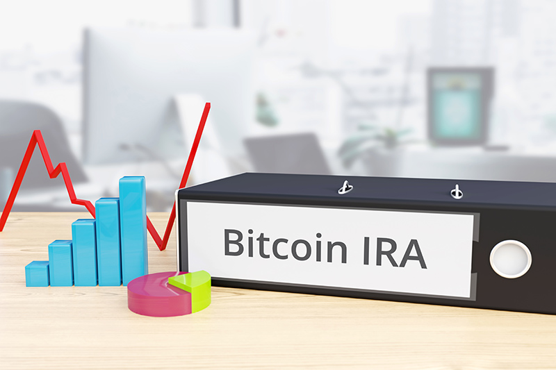 bitcoin ira finance economy folder on desk with label beside diagrams business
